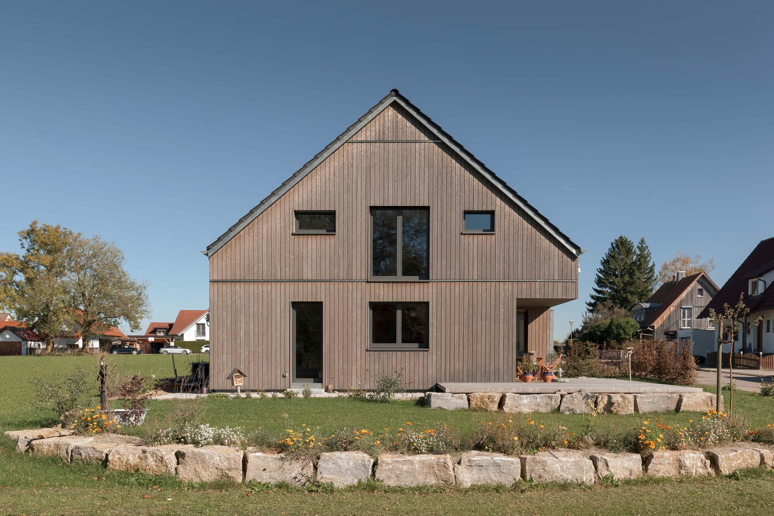 Architekturfotografie Holzhaus mit Vollholzwand von Syno R GmbH aus Lauben im Unterallgäu